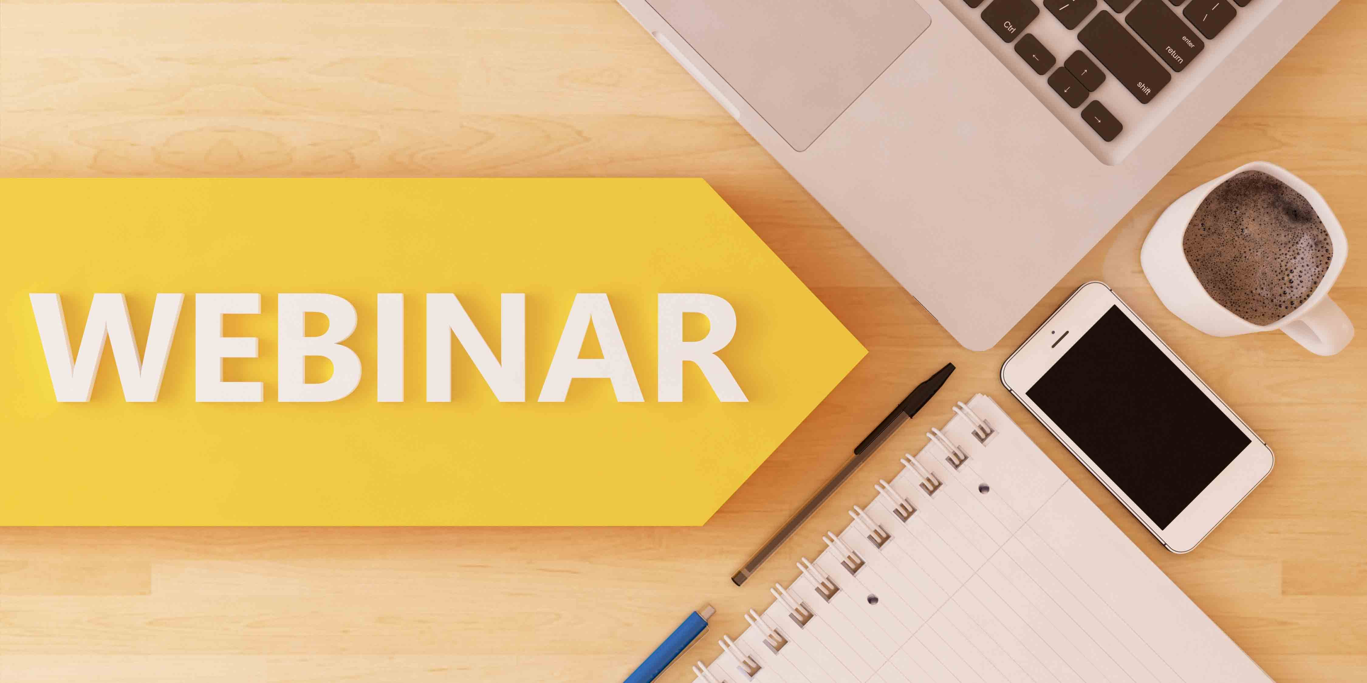Webinar text on yellow arrow next to computer and notebook